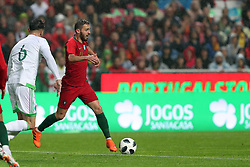 June 7, 2018 - Lisbon, Portugal - Portugal's forward Bernardo Silva (R ) vies with Algerias defender Carl Medjani during the FIFA World Cup Russia 2018 preparation football match Portugal vs Algeria, at the Luz stadium in Lisbon, Portugal, on June 7, 2018. (Portugal won 3-0) (Credit Image: © Pedro Fiuza/NurPhoto via ZUMA Press)