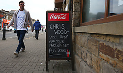 A Leicester City fans walks past a sign outside a pub in Burnley during the Premier League match at Turf Moor, Burnley.