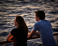 Students waiting for the sun to rise. Aft deck of the MV World Odyssey. Semester at Sea. Spring 2016 Semester Voyage -- Day 15. Crossing the Pacific Ocean from Hawaii to Japan. Image taken with a Nikon 1 V3  camera and 70-300 mm VR lens (ISO 800, 112 mm, f/5.6, 1/60 sec). Raw image processed with Capture One Pro, noise reduction with Topaz DeNoise 5