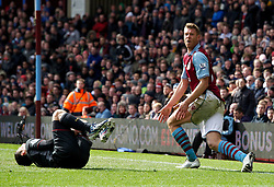 BIRMINGHAM, ENGLAND - Easter Sunday, March 31, 2013: Liverpool's Luis Alberto Suarez Diaz is brought down by Aston Villa's Nathan Baker for a penalty during the Premiership match at Villa Park. (Pic by David Rawcliffe/Propaganda)