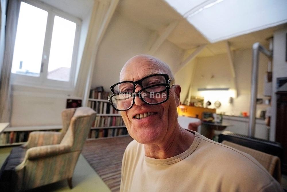 senior male person wearing two eyeglasses for reading, Amsterdam, Gerard DouStraat