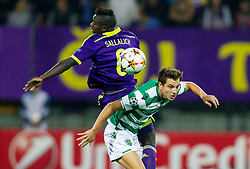 Sintayehu Sallalich of Maribor vs Cédric Doubtful of Sporting during football match between NK Maribor and Sporting Lisbon (POR) in Group G of Group Stage of UEFA Champions League 2014/15, on September 17, 2014 in Stadium Ljudski vrt, Maribor, Slovenia. Photo by Vid Ponikvar  / Sportida.com