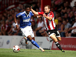 Brentford's Alan Judge battles with Ipswich Town's Ainsley Maitland-Niles - Mandatory by-line: Robbie Stephenson/JMP - 07966386802 - 08/08/2015 - SPORT - FOOTBALL - Brentford,England - Griffin Park - Brentford v Ipswich Town - Sky-Bet Championship