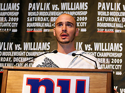 Sept 29, 2009; East Rutherford, NJ, USA; World Middleweight Champion Kelly Pavlik speaks with reporters during the press conference announcing his December 5, 2009 World Middleweight Championship fight against Paul Williams. The two will meet at Boardwalk Hall in Atlantic City, NJ.  Mandatory Credit: Ed Mulholland