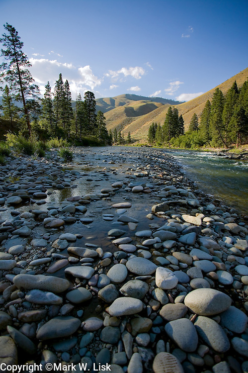 Round granite rocks create a shelf at low water on the Middle Fork of the Salmon River in central Idaho;s Frank Church Wilderness.