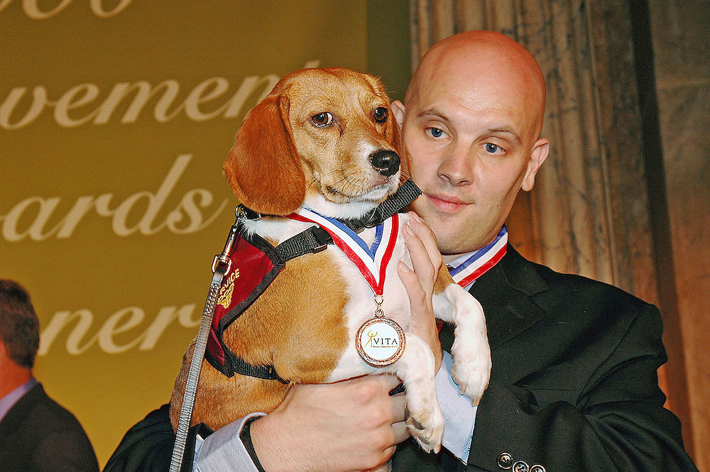 Belle, winner of the VITA Wireless Samaritan Award, presented by the CTIA Wireless Foundation and her owner Kevin Weaver of Ocoee, FL at the awards ceremony at Union Sation in Washington, DC.  Belle, who had been trained to detect Kevin's blood sugar levels and to bite down on the number 9 on his cell phone contacting 911, saved Kevins life on February 7, 2006.