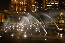 Stock photo of Discovery Green's fountains lit up at night
