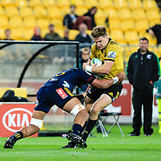 Beauden Barrett tackled during the super rugby union  game between Hurricanes  and Highlanders, played at Westpac Stadium, Wellington, New Zealand on 24 March 2018.  Hurricanes won 29-12.