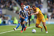 Brighton & Hove Albion centre forward Glenn Murray (17) and Preston North End defender Tommy Spurr (17) during the EFL Sky Bet Championship match between Brighton and Hove Albion and Preston North End at the American Express Community Stadium, Brighton and Hove, England on 15 October 2016.