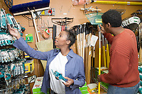 Couple Shopping for Garden Tools