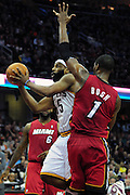 March 29, 2010; Cleveland, OH, USA; Cleveland Cavaliers point guard Baron Davis (85) shoots over Miami Heat power forward Chris Bosh (1) during the second quarter at Quicken Loans Arena. Mandatory Credit: Jason Miller-US PRESSWIRE