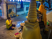 18 FEBRUARY 2015 - BANGKOK, THAILAND: A woman prays at Wat Prayoon, a Buddhist temple south of the Kudeejeen neighborhood in Bangkok. The 186-year-old reliquary stupa known as the Phra Borommathat Maha Chedi was restored along with the adjacent Pharin Pariyattithammasala hall that now houses the Prayoon Bhandakharn Museum at the temple formally known as Wat Prayurawongsawas Worawihan. It won  a 2013 Asia-Pacific Heritage Award for Cultural Heritage Conservation from UNESCO.       PHOTO BY JACK KURTZ