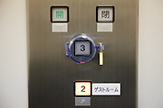Yamazaki, November 22 2011 - Suntory whisky distillery in Yamazaki, Japan. A button of the elevator not allowing to reach the 3rd floor of the main building.
