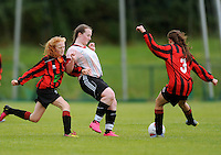 13 Aug 2016:  Eibhlin Shiels, centre, Donegal, in action against Shauna Brennan, left, and Chellene Trill, Galway.  U15 Girls Soccer Semi-final, Galway v Donegal.  2016 Community Games National Festival 2016.  Athlone Institute of Technology, Athlone, Co. Westmeath. Picture: Caroline Quinn
