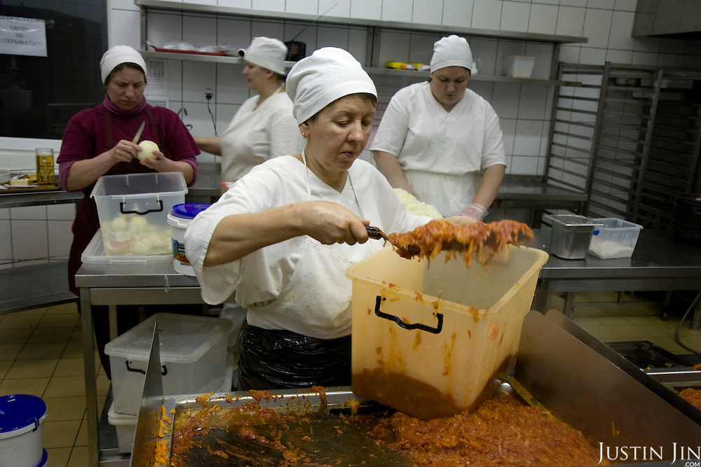 Cooks prepare borscht at the Puzata Khata fastfood restaurant in Kiev, the capital of Ukraine. Borsht is a traditional Ukrainian cuisine that has spreaded via Russia throughout the former Soviet sphere.