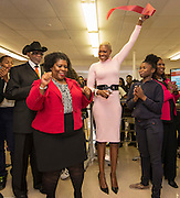 Renita Perry, left, and Trustee Jolanda Jones, right, celebrate with students after a ribbon cutting during a library dedication at Attucks Middle School, January 18, 2017.