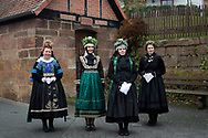 vl: Marburger Tracht (Katholisch), Brautm&auml;dchen, Marburger Tracht (evangelisch), Braut in der Sch&ouml;nsteiner Amtstracht aus dem Gilsberger Hochland (evangelisch)<br /> <br /> Members of the 'Hessische Vereinigung f&uuml;r Tanz- und Trachtenpflege Fachgruppe Brauchtum und Trachten' is wearing an original traditional bridal costume in Marburg, Hesse, Germany on November12, 2016.<br /> <br /> This evangelical traditional costume is from around 1920. Marburg is one of the few areas in Germany where women still wear a traditional costume (around 80 nowadays).<br /> Only pristine women were allowed to wear the bridal crown.<br /> <br /> This is part of the series about Traditional Wedding Gowns from different regions of Germany, worn by young members of local dance groups and cultural associations that exist to preserve and celebrate the cultural heritage. The portraiture series is a depiction of an old era with different social values and religious beliefs in an antiquated civil society with very few of those dresses left.