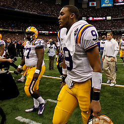 Jan 9, 2012; New Orleans, LA, USA; LSU Tigers quarterback Jordan Jefferson (9) walks off the field with teammates after the 2012 BCS National Championship game against the Alabama Crimson Tide at the Mercedes-Benz Superdome.  Mandatory Credit: Derick E. Hingle-US PRESSWIRE