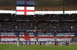 England players observe a minute's silence in honour of the recent terror attacks in England