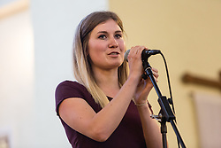 © Licensed to London News Pictures. 26/05/2016. LONDON, UK.  ABBIE GILLGAN, exhibition co-ordinator speaking at the launch of 'East End Women: The Real Story' exhibition at St George-in-the-East church in Shadwell. The exhibition is a response by the East End Women's Collective and 38 Degrees following a series of protests against the nearby controversial Jack the Ripper museum, which had promised to celebrate east end women, but activists opposed and claimed glorified violence against women. A number of feminist groups and activists are still campaigning to get the  Jack the Ripper museum closed. The exhibition runs until 9th July 2016.  Photo credit: Vickie Flores/LNP