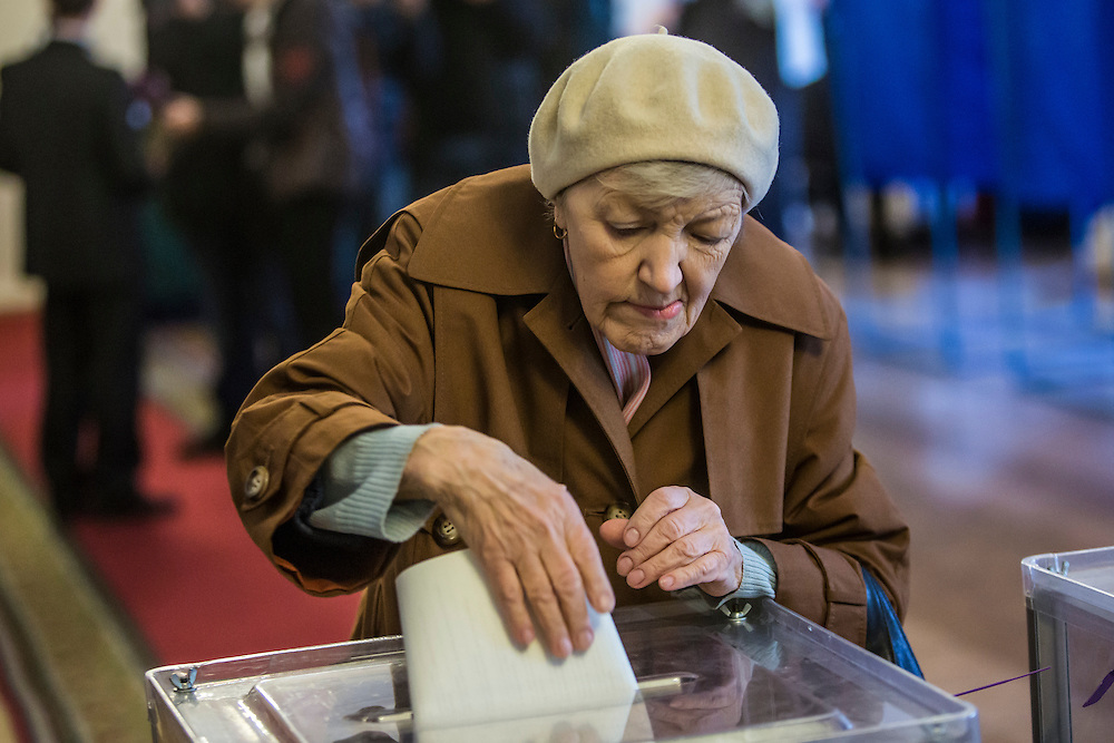 KIEV, UKRAINE - OCTOBER 26: A woman casts her ballot in parliamentary elections on October 26, 2014 in Kiev, Ukraine. Although a low turnout is expected in the east of the country amid continued fighting between Ukrainian forces and pro-Russian separatists, Ukraine is expected to elect a pro-Western parliament in a further move away from Russian influence. (Photo by Brendan Hoffman/Getty Images) *** Local Caption ***
