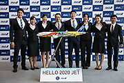 Holdings Inc. President and Chief Executive Officer Shinya Katanozaka shows to media the new design of the plane to promote Tokyo 2020 olympics games after the welcome ceremony for newly hired employees at the company's hanger on April 1, 2017 in Tokyo, Japan. On April 1, 2017 in Tokyo, Japan. Japanese airlines ANA Holdings welcomed 2,800 new employees, the largest number to date for the company. As the majority of Japanese start their career on April 1st after graduating from schools in February or March, it is a custom for large Japanese corporations to hold mass welcoming ceremonies for their new employees. 01/04/2017-Tokyo, JAPAN
