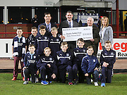 Graham Thomson and Alison McQueen (back right) of Dee Promotions present a &pound;20,000 cheque towards youth development at Dens to Dundee's Tim Keyes and John Nelms - also in the picture are some of the youngsters from Dundee's academy - Dundee v Dundee United - SPFL Premiership at Dens Park<br /> <br />  - &copy; David Young - www.davidyoungphoto.co.uk - email: davidyoungphoto@gmail.com