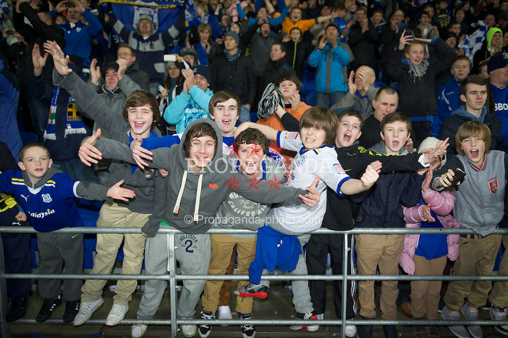 CARDIFF, WALES - Tuesday, January 24, 2012: Cardiff City supporters celebrate their side's penalty shoot-out victory over Crystal Palace during the Football League Cup Semi-Final 2nd Leg at the Cardiff City Stadium. (Pic by David Rawcliffe/Propaganda)