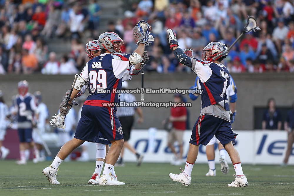 Paul Rabil #99 of the Boston Cannons and Will Manny #1 of the Boston Cannons celebrate a goal during the game at Harvard Stadium on May 17, 2014 in Boston, Massachuttes. (Photo by Elan Kawesch)