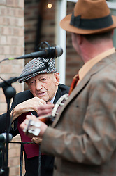 George Fomby impersonator Paul Casper entertains reenactors and members of the public at Northallerton Wartime Weekend is a fund raising event that happens throughout the Yorkshire market town of Northallerton. .With help of volunteers and local business it has been successful in raising money for the charities.Help for Heroes.Royal British Legion.Bomber Command Memorial Charity .Ben Hyde Memorial Fund.<br /> 16/17 June 2012<br /> Image © Paul David Drabble