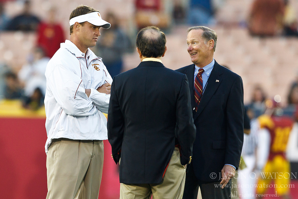 September 11, 2010; Los Angeles, CA, USA;  Southern California Trojans head coach Lane Kiffin (left) talks with athletic director Pat Haden (right) before the game against the Virginia Cavaliers at the Los Angeles Memorial Coliseum.