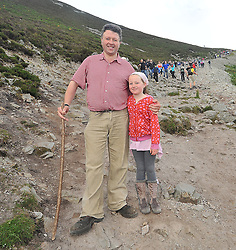 Early Climbers ....Damien Ryan Cathaoirleach of Mayo County Council with his 8 year old daughter Aoife on Croagh Patrick on sunday last.<br /> Pic Conor McKeown