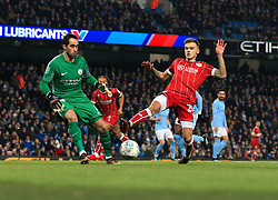 Jamie Paterson of Bristol City stretches for the ball ahead of Claudio Bravo of Manchester City  - Mandatory by-line: Matt McNulty/JMP - 09/01/2018 - FOOTBALL - Etihad Stadium - Manchester, England - Manchester City v Bristol City - Carabao Cup Semi-Final First Leg