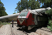 view of the rescue operations at the site of a derailed train near the central city of Netanya, Israel, Monday June 12, 2006. A train packed with hundreds of passengers hit a pickup truck  , causing a locomotive and three carriages to overturn, killing one person and injuring more than 60 passengers