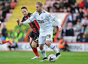 Barry Bannan and Marc Pugh during the Sky Bet Championship match between Bournemouth and Bolton Wanderers at the Goldsands Stadium, Bournemouth, England on 27 April 2015. Photo by Adam Rivers.