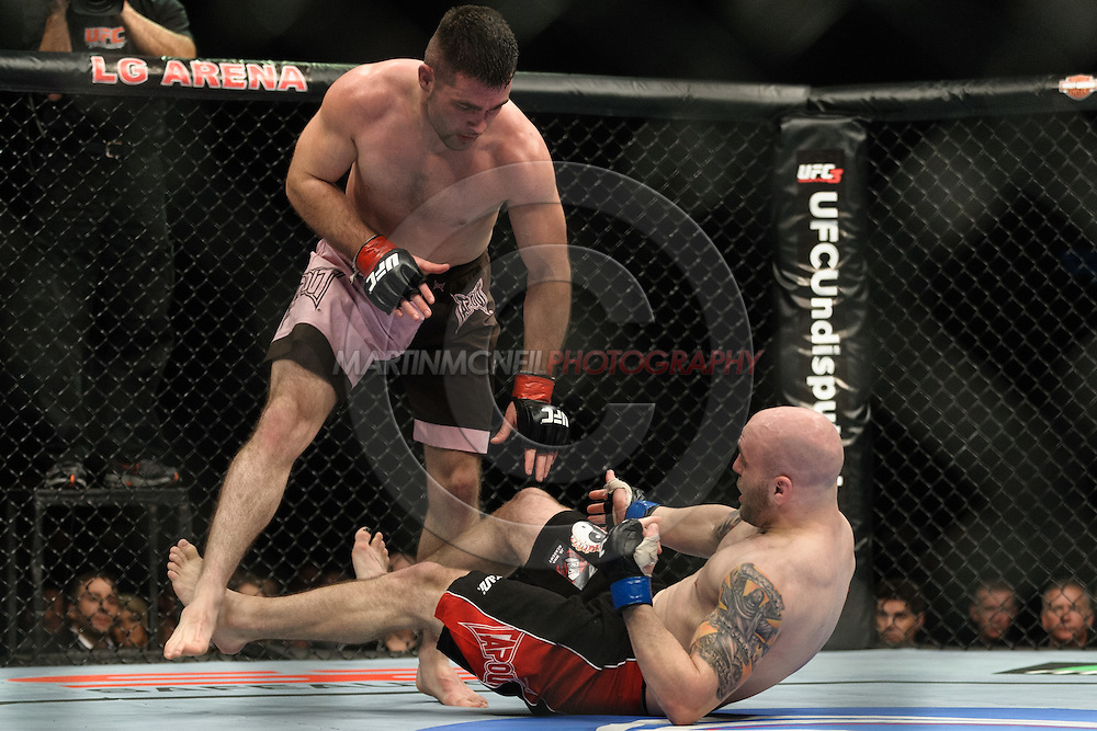 "BIRMINGHAM, ENGLAND, NOVEMBER 5, 2012: John Maguire (standing) looks for an opening in the defence of a grounded Justin Edwards during ""UFC 138: Munoz vs. Leben"" inside the National Indoor Arena in Birmingham, United Kingdom"