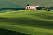 An isolated farm house in the hills of the Orcia Valley not far from Pienza, Tuscany, Italy