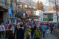 People flow through Whistler Village during the 2010 Olympic Winter Games in Whistler, BC Canada.