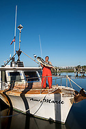 Mark Marhefka with his boat the Amy Marie in Shem Creek. Mark is the owner of Abundant Seafood and supplies many local restaurants, including HUSK.
