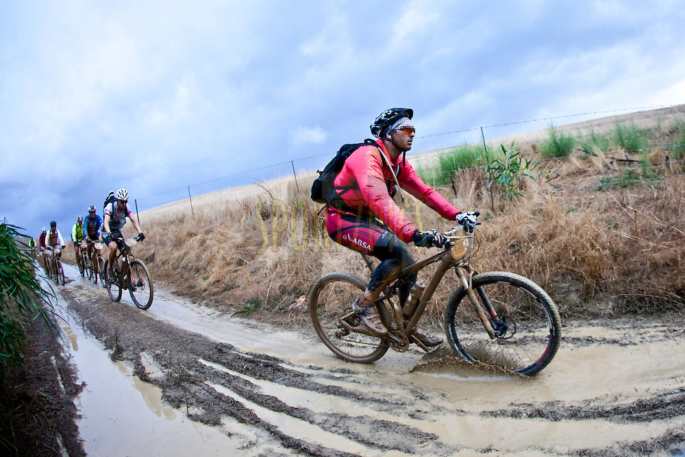 Muddy conditions prevail during stage 5 of the 2012 Absa Cape Epic Mountain Bike stage race from the Overberg Primary & High School in Caledon to Oak Valley Wine Estate in the Elgin Valley, South Africa on the 30 March 2012..Photo by Karin Schermbrucker/Cape Epic/SPORTZPICS