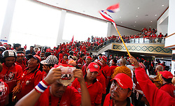 Red shirt protesters broke the glass walls and storm the Pattaya Exhibition and Convention Centre, the venue for the Association of South East Asian Nations (ASEAN)-China plus six summit in Pattaya, Thailand, 11 April 2009. Thai government decided to postpone indefinitely the Asean summit after thousands of red-shirts protesters loyal to fugitive former premier Thaksin Shinawatra broke into a hotel where is the venue of the summit of the Association of South-East Asian Nations (ASEAN) at the Thai seaside resort of Pattaya.