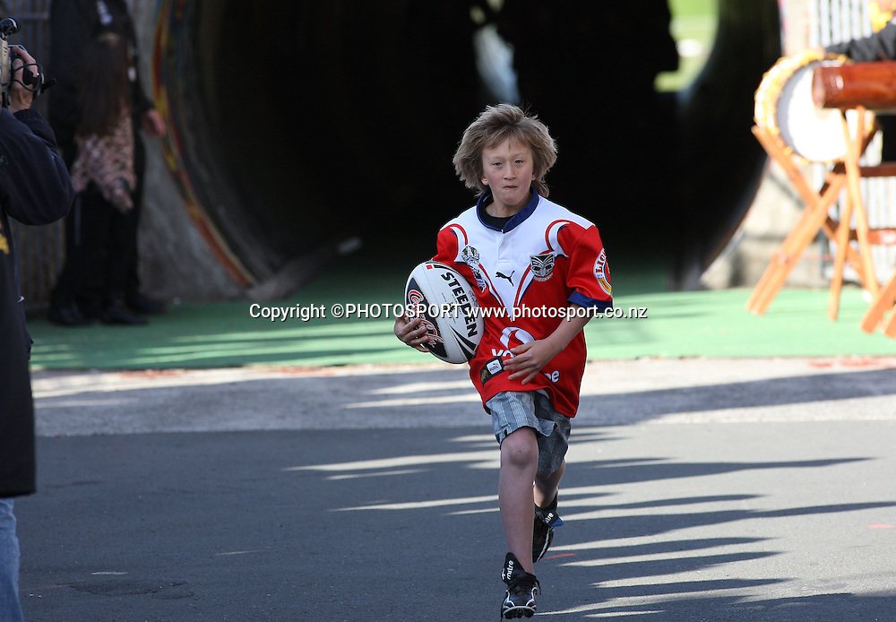 A young fan takes the match ball onto the field. NRL, Vodafone Warriors v Penrith  Panthers, Mt Smart Stadium, Auckland, Sunday 31 August 2008. Photo: Andrew Cornaga/PHOTOSPORT