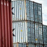 Shipping containers are stacked on top of each other at Ushuaia Port, Argentina.