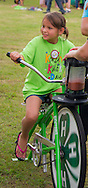 4-H Blender Bikes in the park at Shawnee.<br /> The blender bikes were used to help educate youth about healthy snacks by allowing them to use the bikes to make fruit smoothies. Nutrition educators helped make the frozen fruit smoothies and the children pedaled the bikes.