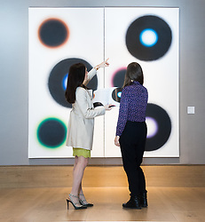 Bonhams, London, March 6th 2017. Fine art auctioneers Bonhams hold a preview in London  for their upcoming Post-War and Contemporary Art Sale which takes place on March 8th 2017. PICTURED: Two women discuss Wojciech Fangor's diptych 'NJ15' from 1964 which is expected to fetch between £140,000 and £180,000.