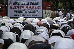 October 14, 2016 - Central Jakarta, Jakarta, Indonesia - Jakarta, Indonesia, 14 October 2016 : Thousands of people from religius community in Indonesia rally infront of Jakarta Governor Office. The religius community protest Jakarta Governor Basuki Tjahja Purnama that was giving speech to fishermen at thousands island mocking a verse from Al Quran. The statement giving hars reaction from leader of Islam Religius community. (Credit Image: © Donal Husni via ZUMA Wire)
