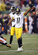 Pittsburgh Steelers wide receiver Markus Wheaton (11) drops the ball in celebration after catching a second quarter pass good for a gain of 24 yards and a first down at the Cincinnati Bengals 25 yard line during the NFL AFC Wild Card playoff football game against the Cincinnati Bengals on Saturday, Jan. 9, 2016 in Cincinnati. The Steelers won the game 18-16. (©Paul Anthony Spinelli)