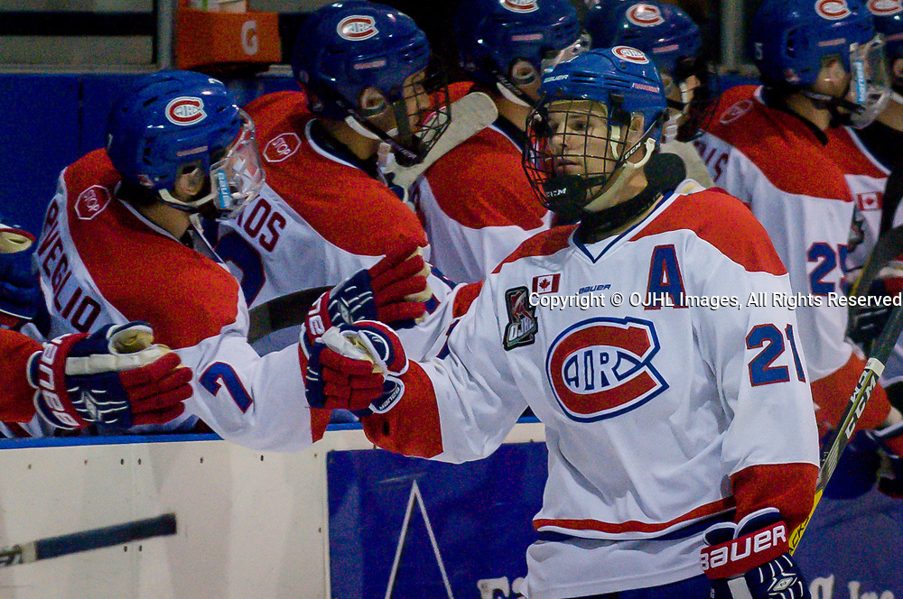 TORONTO, ON  - SEP 8,  2017: Ontario Junior Hockey League game between the St. Michael&rsquo;s Buzzers and the Toronto Jr. Canadiens, Jason Pineo #21 of the Toronto Jr. Canadiens greeting his team-mate after the goal.<br /> (Photo by Anatoliy Cherkasov / OJHL Images)