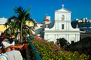 PUERTO RICO, SAN JUAN World Heritage Site; the Cathedral built between 1521 and 1852, seen beyond the deck of the El Convento Hotel