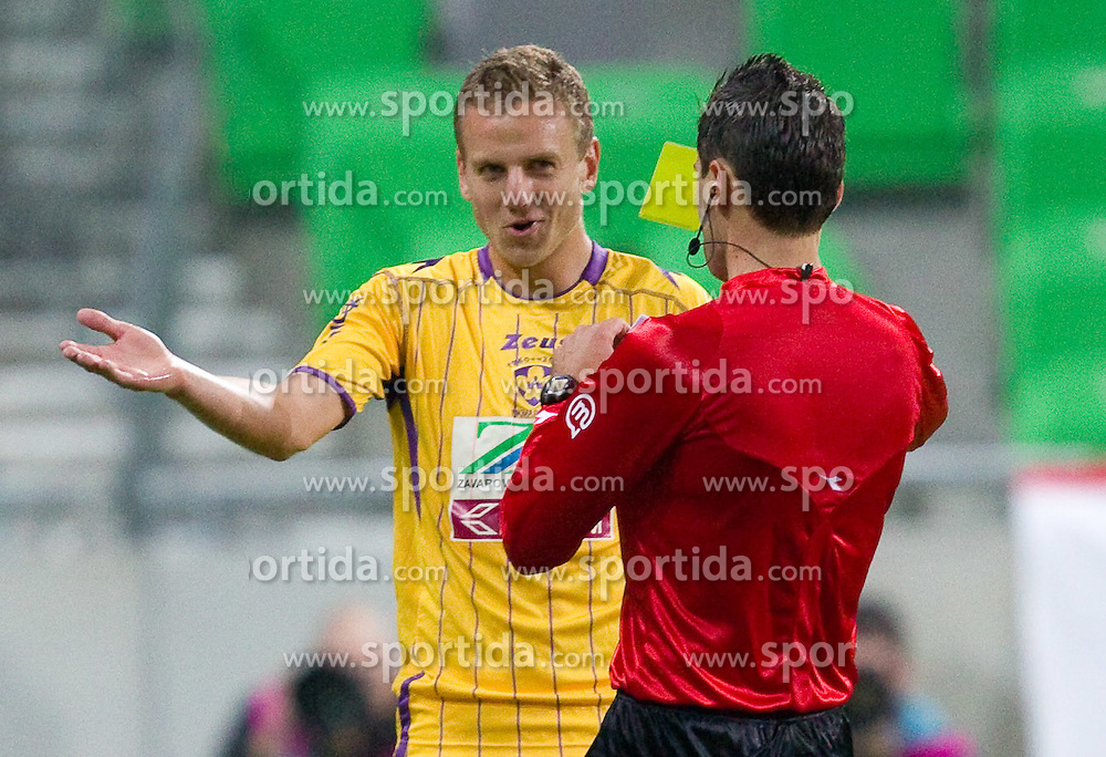 Ales Mertelj of Maribor and referee Damir Skomina during the football match between NK Olimpija and NK Maribor, played in the 4th Round of Prva liga football league 2010 - 2011, on September 29, 2010, in Stozice, Ljubljana, Slovenia. Maribor defeated Olimpija 1 - 0. (Photo by Vid Ponikvar / Sportida)